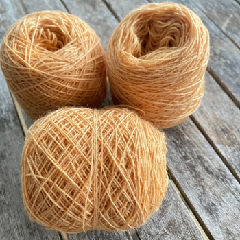 orange wool yarn sewing weaving plantdyed